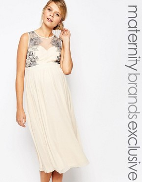 photo Lace Overlay Sleeveless Skater Dress by Little Mistress Maternity, color Cream - Image 1