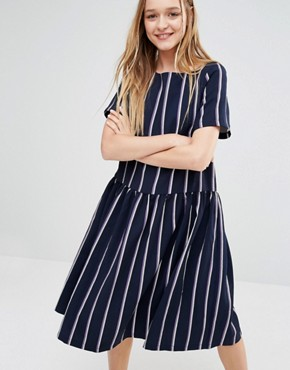 photo Oversized Smock Dress with Drop Waist in Stripe by I Love Friday, color Navy - Image 1