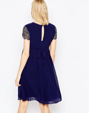 photo Skater Dress with Embellished Sleeves by Little Mistress Maternity, color Navy - Image 2
