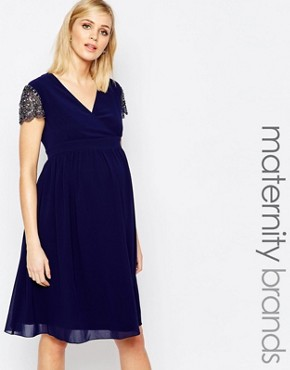 photo Skater Dress with Embellished Sleeves by Little Mistress Maternity, color Navy - Image 1