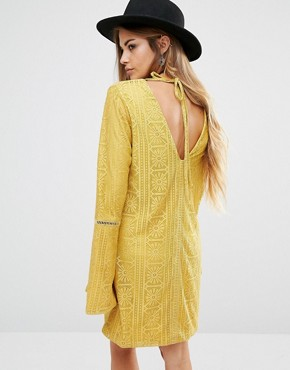 photo Lace Dress with Low Back by Lira, color Mustard - Image 2