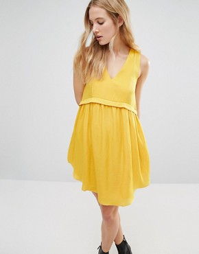 photo Alhena Smock Dress with Pockets by d.RA, color Mustard - Image 1