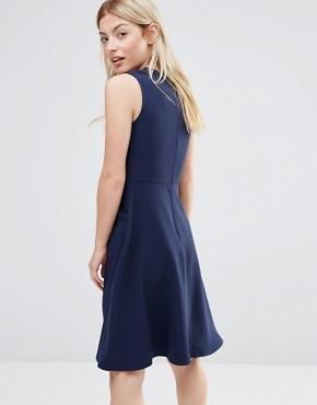 photo Ruffle Pocket Pinafore Dress by Alter, color Navy - Image 2