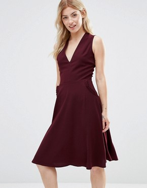 photo Ruffle Pocket Pinafore Dress by Alter, color Burgandy - Image 1
