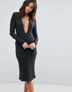 photo Long Sleeve Plunge Front Dress In Black by NYTT, color Black - Image 1