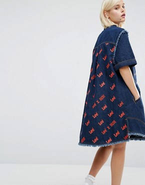 photo Denim Shirt Dress with All Over Back Logo by House of Holland, color Blue - Image 1