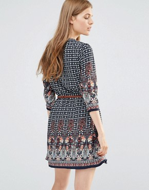 photo Belted Dress With 3/4 Sleeves In Border Print by Yumi, color Navy - Image 2
