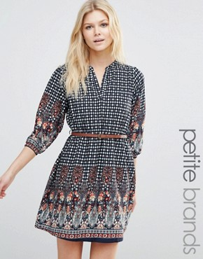 photo Belted Dress In Border Print by Yumi Petite, color Navy - Image 1