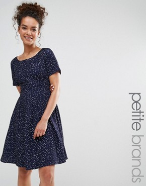 photo Dress with Tie Back In Polka Dot Print by Yumi Petite, color Navy - Image 1