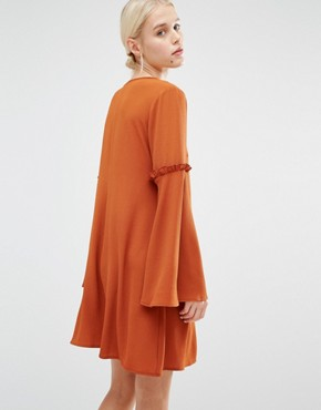 photo Swing Dress with Bell Sleeves & Ruffles by Lost Ink, color Rust - Image 2