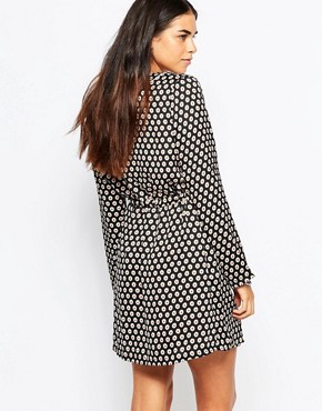 photo Stay Curious Wrap Dress In Daisy Dot Print by Goldie, color Black - Image 2