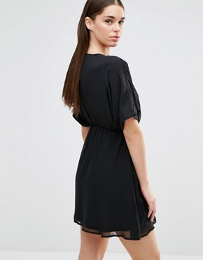 photo Kimono Sleeve Plunge Skater Dress by Twin Sister, color Black - Image 2
