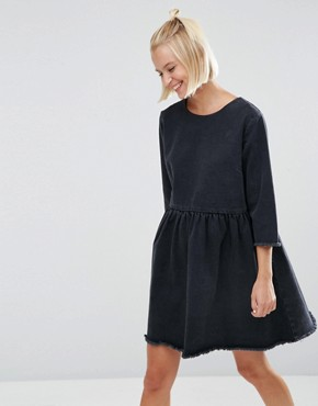 photo Denim Smock Dress with Raw Hem in Washed Black by ASOS, color Washed Black - Image 1