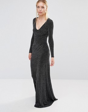 photo Backless Long Sleeved Maxi Dress In Lurex Fabric by City Goddess, color Black - Image 1