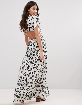 photo Shadow Tulip Maxi Dress with Cut Outs by d.RA, color White - Image 1