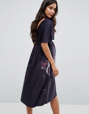 photo Printed Flutter Sleeve Hi Lo Midi Dress by Hope & Ivy Maternity, color Purple - Image 2