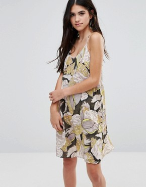 photo Cami Dress In 70sPrint by Traffic People, color Green - Image 1