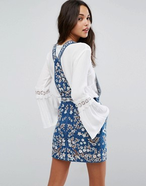 photo Denim Embroidery Pinafore Dress by Needle & Thread, color Washed Indigo - Image 2