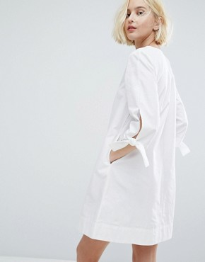 photo Minimal A-Line Dress with Tie Sleeve Details by Native Youth, color White - Image 2