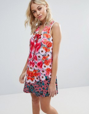 photo Poppy Blossoms Neoprene Dress by Clover Canyon, color Poppy Blossom - Image 1