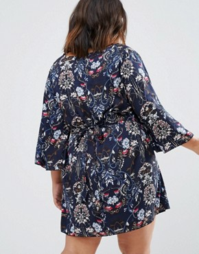 photo Smock Dress In Floral by Yumi Plus, color Navy - Image 2