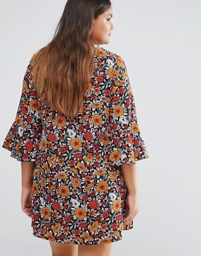 photo Shift Dress with Frill Sleeves In Floral Print by Yumi Plus, color Rust - Image 2