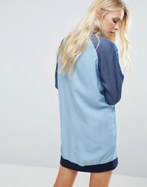 photo Raegan Denim Dress with Contrast Sleeves by Little White Lies, color Blue - Image 2