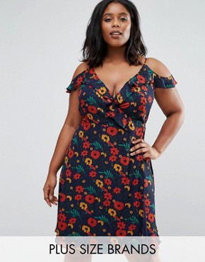 photo Wrap Dress with Ruffle Detail In Floral Print by Koko Plus, color Navy Floral - Image 1