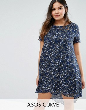 photo Swing Dress with Dip Back In Floral Print by Koko Plus, color Grey - Image 1