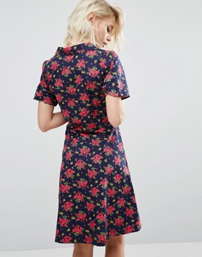 photo Floral Print Tea Dress by Trollied Dolly, color Navy Upholstery - Image 2