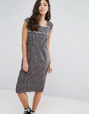 photo Peace Out Pom Pom Trim Dress by Trollied Dolly, color Navy Floral - Image 1