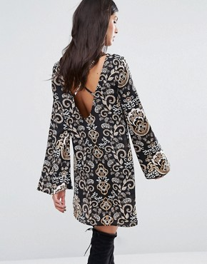 photo Cross Back Printed Swing Dress by Missguided, color  - Image 1