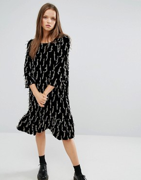 photo Frill Hem Smock Dress with All Over Embellishment by STYLENANDA, color Black - Image 1