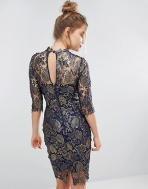 photo Metallic Lace Pencil Dress with High neck and 3/4 sleeve by Paper Dolls, color Metallic Navy Gold - Image 2