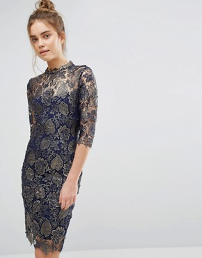photo Metallic Lace Pencil Dress with High neck and 3/4 sleeve by Paper Dolls, color Metallic Navy Gold - Image 1