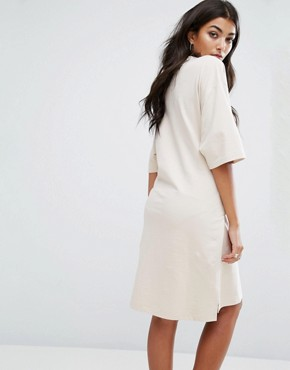 photo Oversized Sweat T-Shirt Dress with Tie Waist by Ellesse, color Cream - Image 2