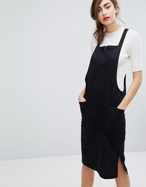 photo Organic Cotton Pinnafore Dress With Ring Pull Zip by People Tree, color Black - Image 1