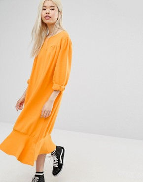 photo Drop Hem Smock Dress by STYLENANDA, color Yellow - Image 1