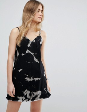 photo Denim Slip Dress in Washed Black with Bleach Print by ASOS, color Washed Black - Image 1