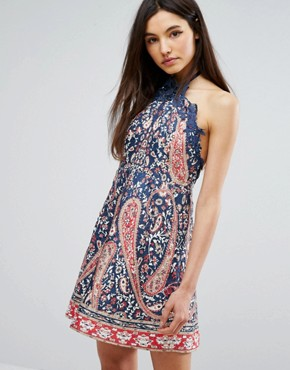 photo Halter Neck Printed Skater Mini Dress by Comino Couture, color Blue - Image 1