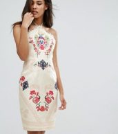 photo Halter Neck Printed Midi Dress by Comino Couture, color Cream/Red - Image 1