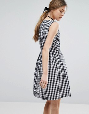 photo Gingham Skater Dress with Cherry Badge by Trollied Dolly, color Black & White Gingha - Image 2