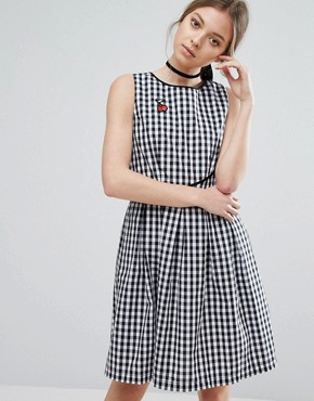 photo Gingham Skater Dress with Cherry Badge by Trollied Dolly, color Black & White Gingha - Image 1
