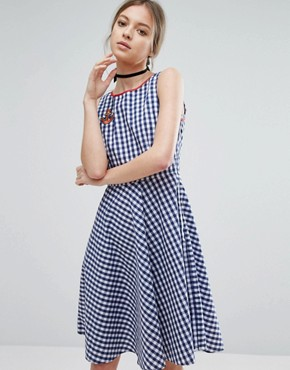 photo Gingham Skater Dress with Anchor Badge by Trollied Dolly, color Navy Gingham - Image 1