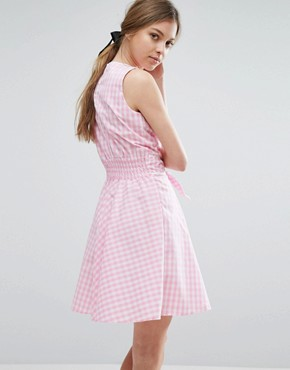 photo Gingham Skater Dress with Tie Waist and Rose Badge by Trollied Dolly, color Pink Gingham - Image 2
