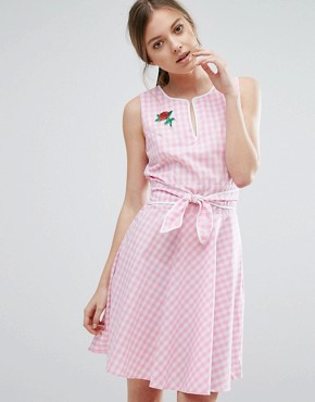 photo Gingham Skater Dress with Tie Waist and Rose Badge by Trollied Dolly, color Pink Gingham - Image 1