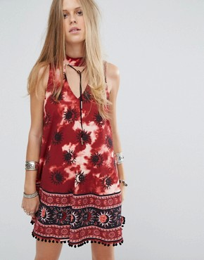 photo Choker Detail Swing Dress In Tie Dye Sun Print by Kiss The Sky, color Red - Image 1