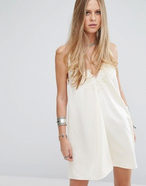photo Halter Neck Slip Dress with Lace Insert and Tassel Ties by Kiss The Sky, color Cream - Image 1
