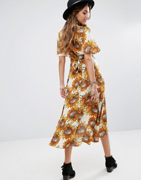 photo Wrap Front Midi Tea Dress In Golden Sunflower Print by Kiss The Sky, color Yellow - Image 2