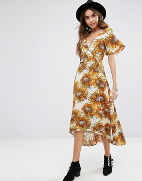 photo Wrap Front Midi Tea Dress In Golden Sunflower Print by Kiss The Sky, color Yellow - Image 1